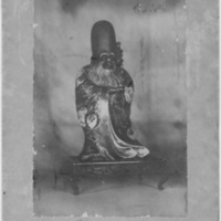Picture of Gilded Statue on Wooden Bench Inscribed Long Life