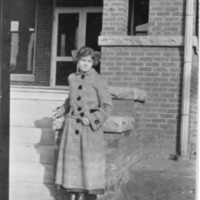 Mary Lou Flynn at Age 16 Standing in Front of Brick Building - Picture Postcard