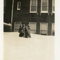 Two Women Standing in Snow