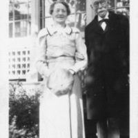 Elderly Man (Frederick Charles Jennings) and Woman (Mary Stuart Carter Tyler-Jennings) Standing in Front of House