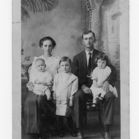 W.B. Sprinkle, Woman and Three Children  with  - Picture Postcard - Handwritten: Maggie, Mammie and Reuben