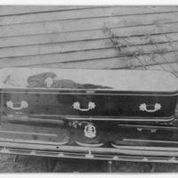 Boy in Casket Placed Next to Building - Handwritten: Preston Williams 1908