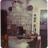 Room in Ripshin (Sherwood Anderson House) with Rock Fireplace, Decorated with Bearskin Rug, Mounted Big Horn Sheep Trophy, and Handicrafts