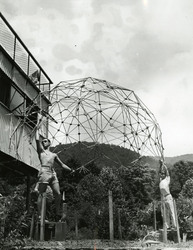 Photo, Buckminster Fuller's students demonstrate the lightness of the dome at the 1949 Summer Institute.